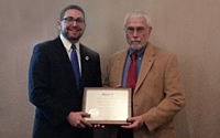 (Left to right) John D. Russell, JD receives an appreciation award from ASA's Washington, DC Chapter President Joseph A. Grouby, ASA.