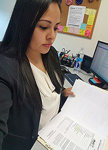 Nathaly Alcocer reviewing course documentation